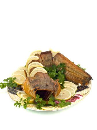 sheatfish: Sabrosa cena - estaba repleto de agua dulce de bagre (sheatfish) con lim�n y perejil en la placa  Foto de archivo
