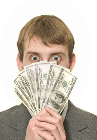 Surprised or amazed Businessman with hundreds of dollars isolated over white Stock Photo - 6073795