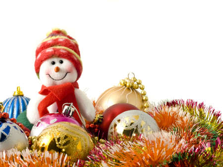 Christmas snowman and decoration baubles over white photo