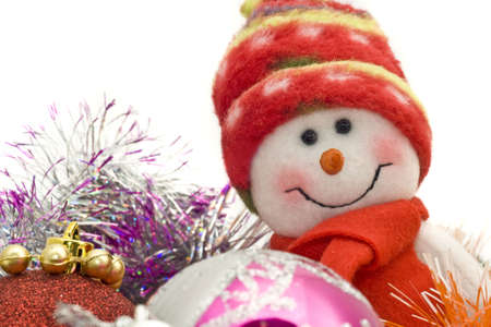 Cute Xmas snowman and decoration baubles over white photo