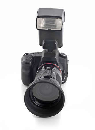 Professional DSLR camera with telephoto lens and flash isolated over white Stock Photo - 6091419