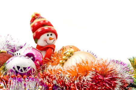 Funny snowman and decoration balls over white photo