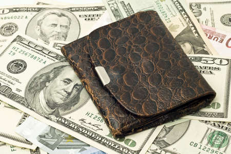 50 dollar bill: Save the money - old wallet, US dollars and euro banknotes Stock Photo