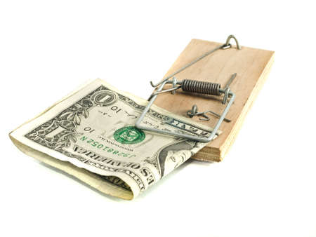 One Dollar in the mousetrap over white background photo