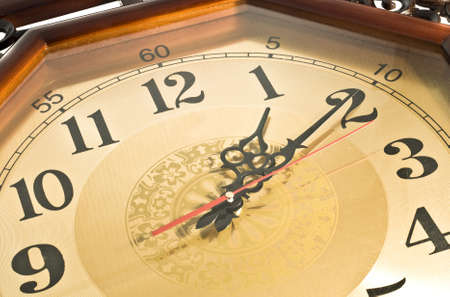Close-up of Antique clock over white background photo