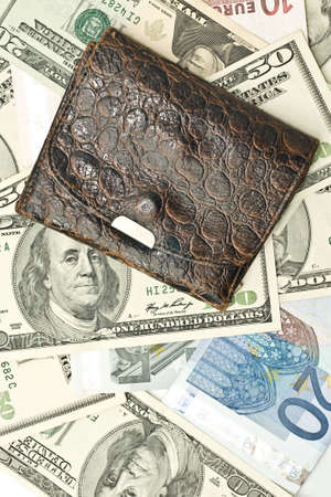 Save the money - old wallet, US dollars and euro banknotes photo
