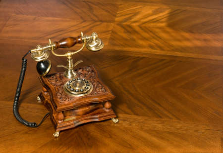 Old-fashioned telephone on the wooden table Stock Photo - 6403249