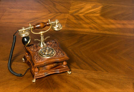 Old-fashioned telephone on the wooden table photo