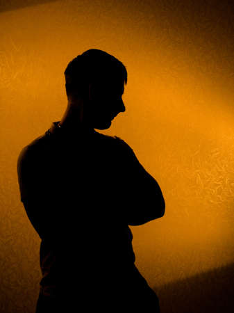 darkness: Thinking of something. silhouette of man in the darkness