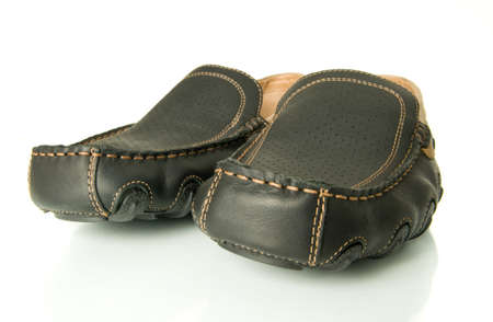 moccasins: Close-up of black mens shoes moccasins over white. Wide-angle shot. Stock Photo