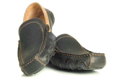 moccasins: Modern footwear. Black mens shoes moccasins over white. Wide-angle shot. Stock Photo