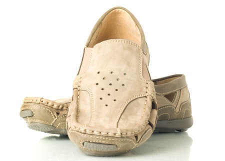 moccasins: Pair of modern beige mens shoes moccasins over white Stock Photo