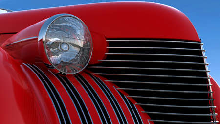 Headlight and engine jacket of red retro car over blue sky background photo