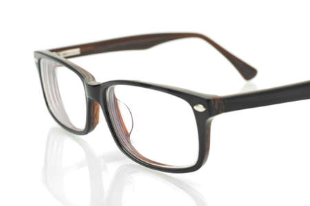 foreshortening: Close-up of modern eyeglasses over white background