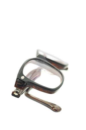 shortsightedness: Modern eyeglasses over white background (shallow DOF)
