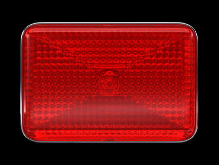 Red button or headlight isolated over black photo