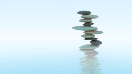 Stability and balance concept. Plie of Pebbles on water surface photo