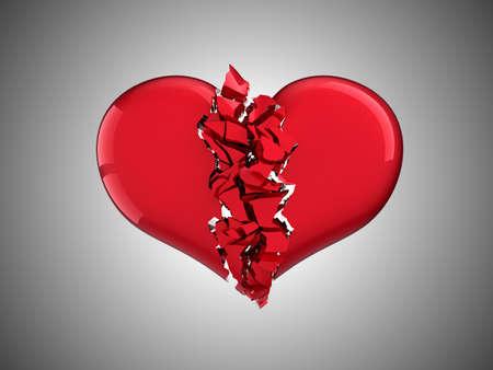 corazon roto: El divorcio y el amor. Coraz�n roto sobre fondo gris Foto de archivo