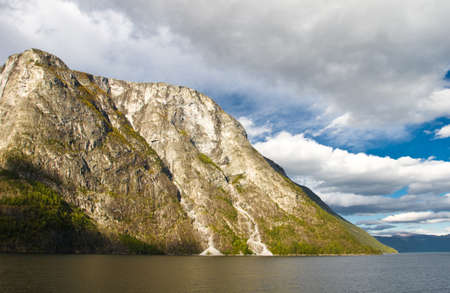 Mountains and fjord in Norway. Cloudy sky photo