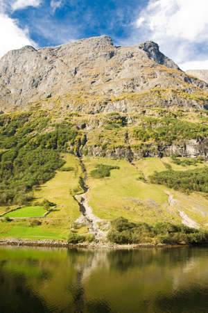 neroyfjord: Mountain of norwegian fjord in Norway. Clouds and blue sky