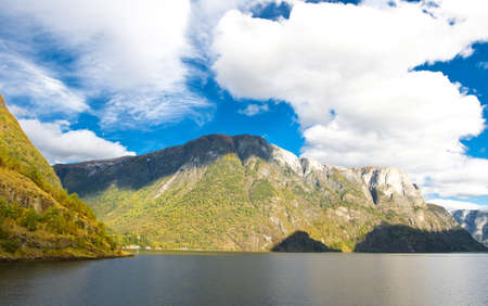Mountains and fiords -  norwegian landscape. Clouds and blue sky photo
