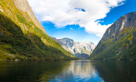 fiord: Mountains and fjord in Norway. Clouds and blue sky Stock Photo