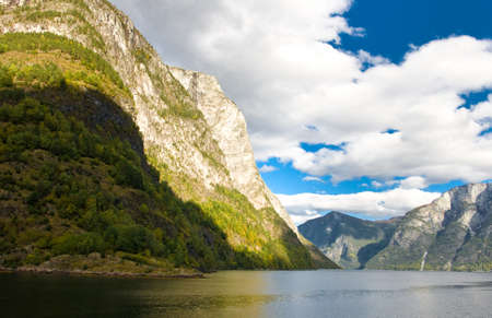 Mountains, norwegian fjords and blue sky photo