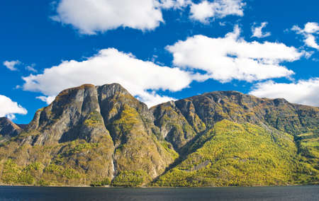 Norwegian landscapes. Fiords, mountains and blue sky photo