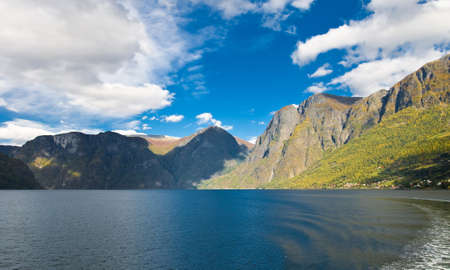 Norwegian nature. Fiords, mountains and blue sky photo