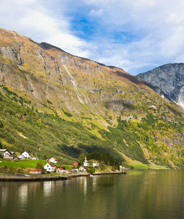 neroyfjord: Life in Norway: fjord, mountains and village on the river bank Stock Photo