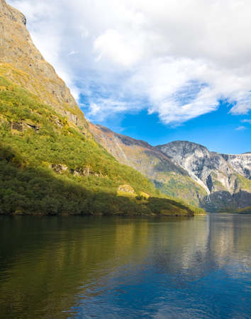 neroyfjord: Norwegian fjords in autumn: Mountains, river and blue sky Stock Photo