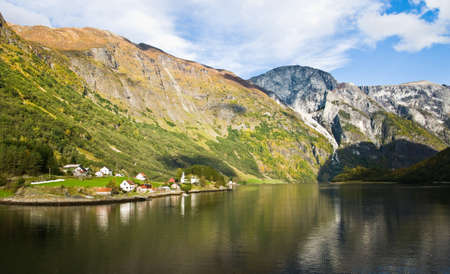 Scandinavian landscape: Fjord, mountains and village photo