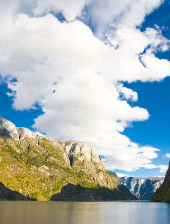 Norwegian fjord in autumn: Mountains and blue sky photo