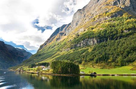 neroyfjord: Norwegian fjords: Mountains, village and blue sky