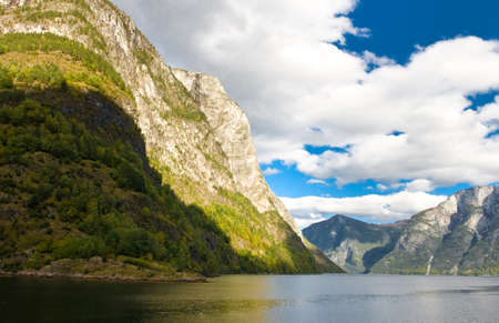 neroyfjord: Norwegian Fjord: Mountains and cloudy sky in autumn Stock Photo