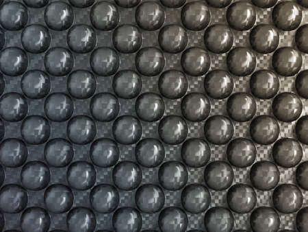 Abstract Carbon fiber with pimples. Useful as background photo