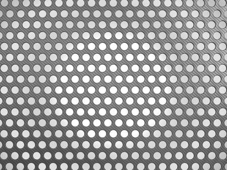 composit: Carbon fibre surface with holes over studio light background