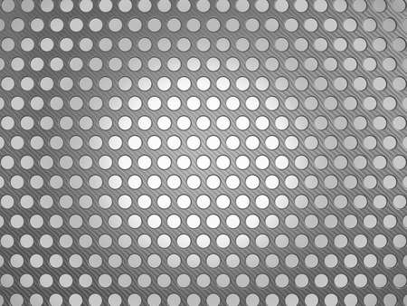 Carbon fiber surface with holes over studio light background Stock Photo