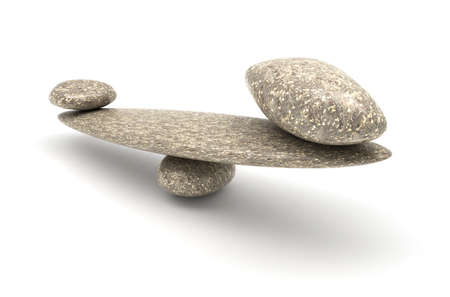 Harmony and Balance: Pebble stability scales with large and small stones Stock Photo