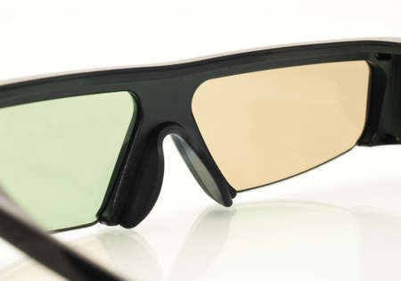Stereo 3D TV: close up of active shutter glasses on white photo