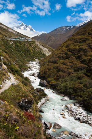 Himalaya landscape: peak, river and highland village. Pictured in Nepal photo