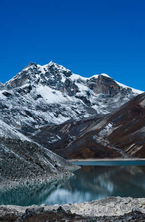 himalayas: Mountain near Gokyo and Sacred lake in Himalayas. Shot in Nepal, 4800 m Stock Photo