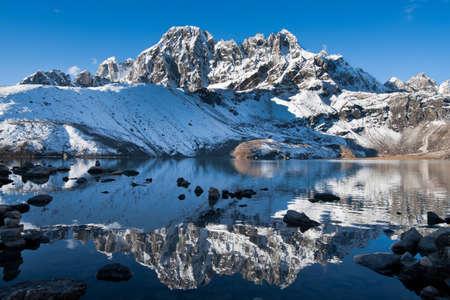 himalayas: Sacred Gokyo Lake and mountain peak in Himalayas. Altitude 4800 m