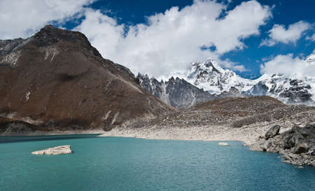 Sacred Lake and mountain peaks not far from Gokyo in Himalayas. Altitude 4800 m Stock Photo - 12769441