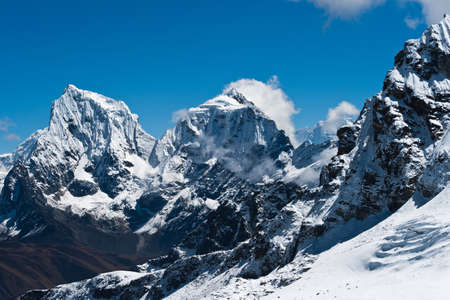 Cholatse and Taboche summits viewed from Renjo Pass (at height 5300 m)  photo