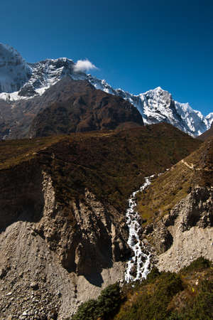 Himalaya landscape: stream and snowed peaks. Captured in Sagarmatha National park Stock Photo - 12901808