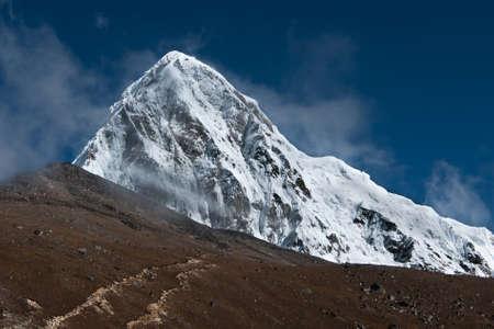 himalayas: Pumori, Kala Patthar and cloudy sky in Himalayas. Nepal (shot on height 5100-5200 m)