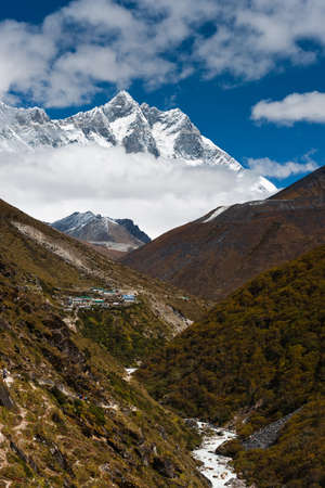 Summits Lhotse and Lhotse shar. Village and stream in Himalayas. Pictured in Nepal photo