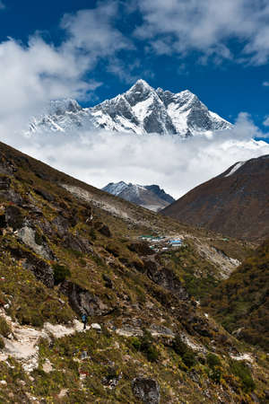 Lhotse and Lhotse shar peaks. Village and tourists photo