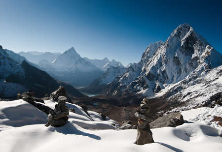 alpinism: Cho La pass and stone stacks at daybreak in Himalayas. Hiking in Nepal